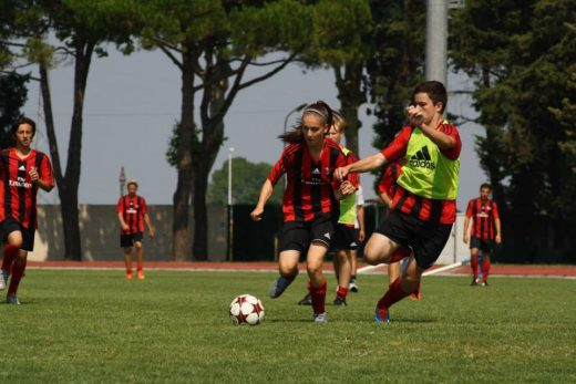 Girls play soccer at the AC Milan Camp