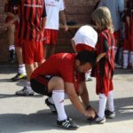 AC Milan Camp staff affection for children
